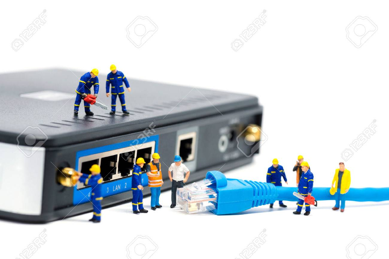 43216786-technicians-connecting-network-cable-network-connection-concept-macro-photo